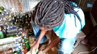 Group of workers device ways of recycling wine and beer bottles to make wine and glasses in Kilifi