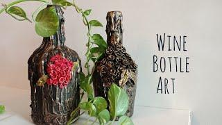 Wine Bottle art/Antique bottle/Clay art on bottle/ Altered bottle