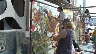 Foreign, local artists paint Central Bus station wall in Vadodara