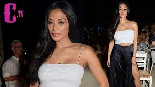 Nicole Scherzinger flashes her tiny stomach in crop top and soaring split trousers in Mykonos